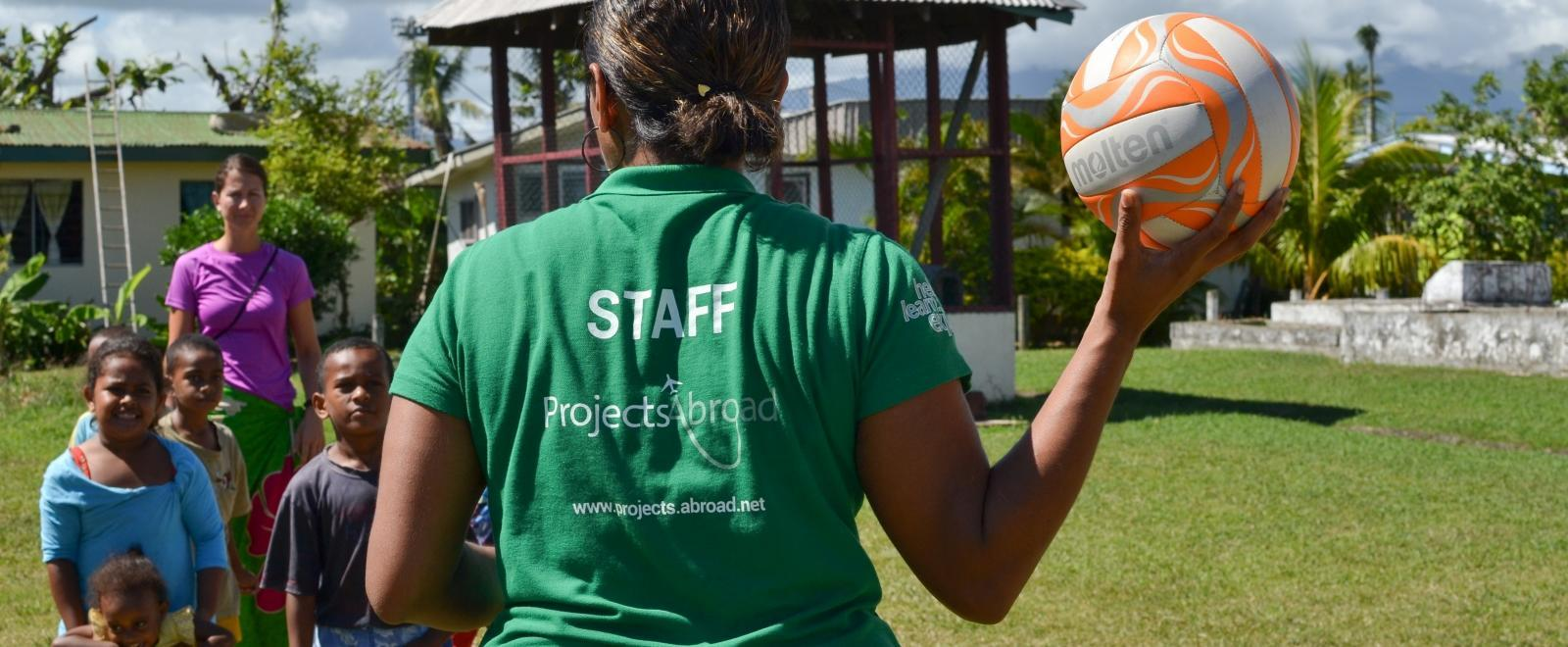 A local Projects Abroad staff member is taking care of the safety of the volunteers and kids in Fiji.
